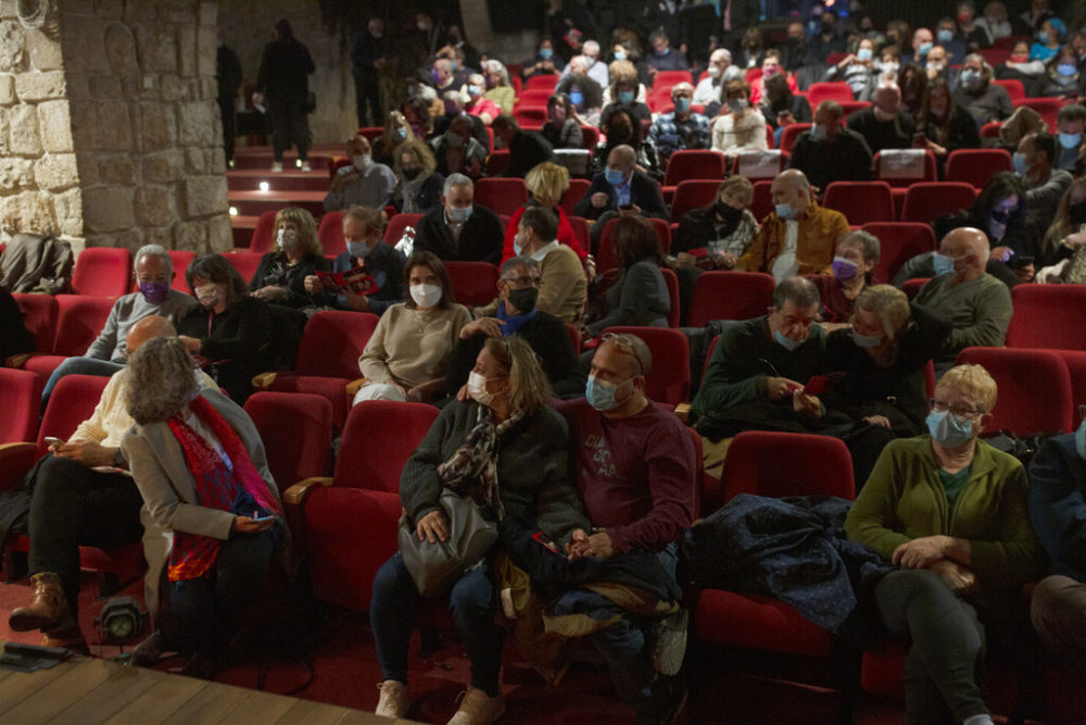 The audience waits on opening night at the Khan Theater during a performance where all guests were required to show proof of receiving a COVID-19 vaccination or full recovery from the virus, in Jerusalem, Tuesday, Feb. 23, 2021.  (Maya Alleruzzo/AP Photo)