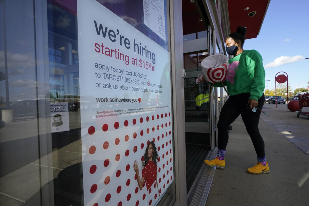 In this Sept. 30, 2020, file photo, a passerby walks past a hiring sign while entering a Target store in Westwood, Mass. (Steven Senne/AP File)