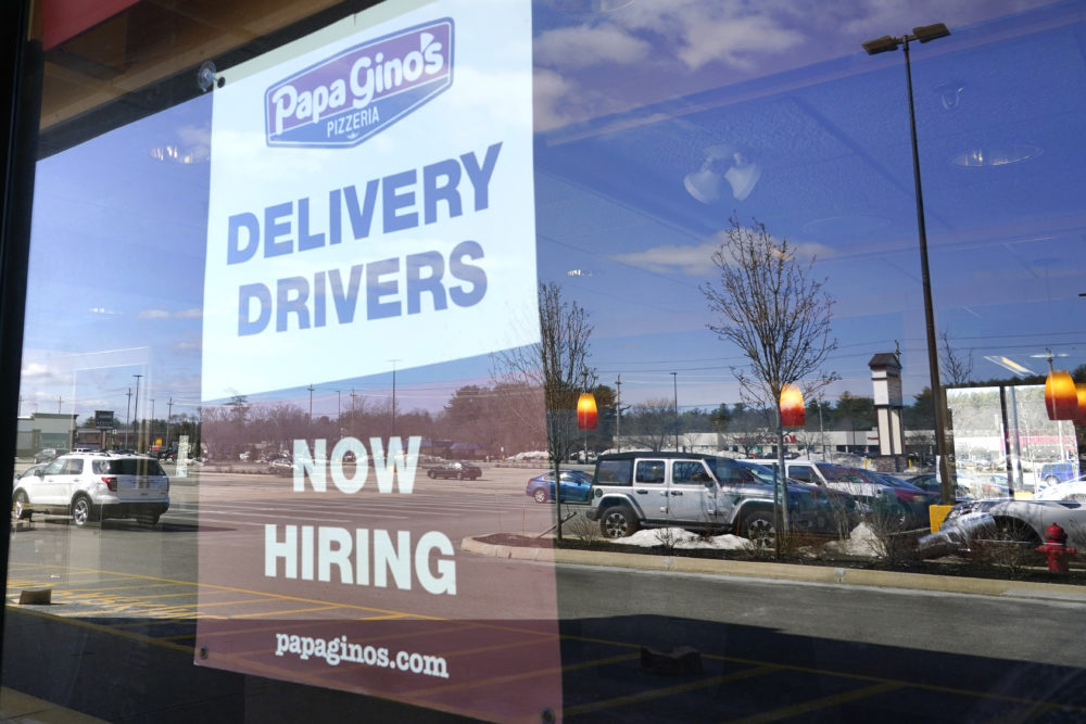 "A ""Now Hiring"" sign is displayed, Thursday, March 4, 2021, in Salem, N.H. (Elise Amendola/AP)"
