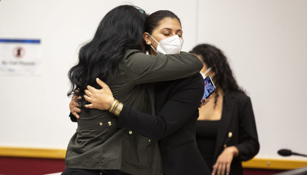 Des Moines Register reporter Andrea Sahouri, facing, hugs her mother after being found not guilty at the conclusion of her trial on March 10, 2021, in Des Moines, Iowa. An Iowa jury acquitted Sahouri, who was pepper-sprayed and arrested by police in the summer of 2020 while covering a protest in a case that critics have derided as an attack on press freedom and an abuse of prosecutorial discretion. (Kelsey Kremer/The Des Moines Register via AP, Pool)