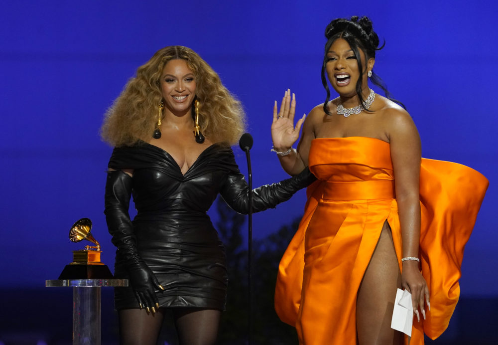 """Beyonce, left, and Megan Thee Stallion accept the award for best rap song for """"Savage"""" at the 63rd annual Grammy Awards at the Los Angeles Convention Center on Sunday, March 14, 2021. (Chris Pizzello/AP)"""