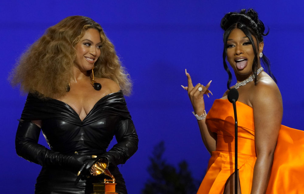 "Beyonce, left, and Megan Thee Stallion accept the award for best rap song for ""Savage"" at the 63rd annual Grammy Awards at the Los Angeles Convention Center on Sunday, March 14, 2021. (Chris Pizzello/AP)"
