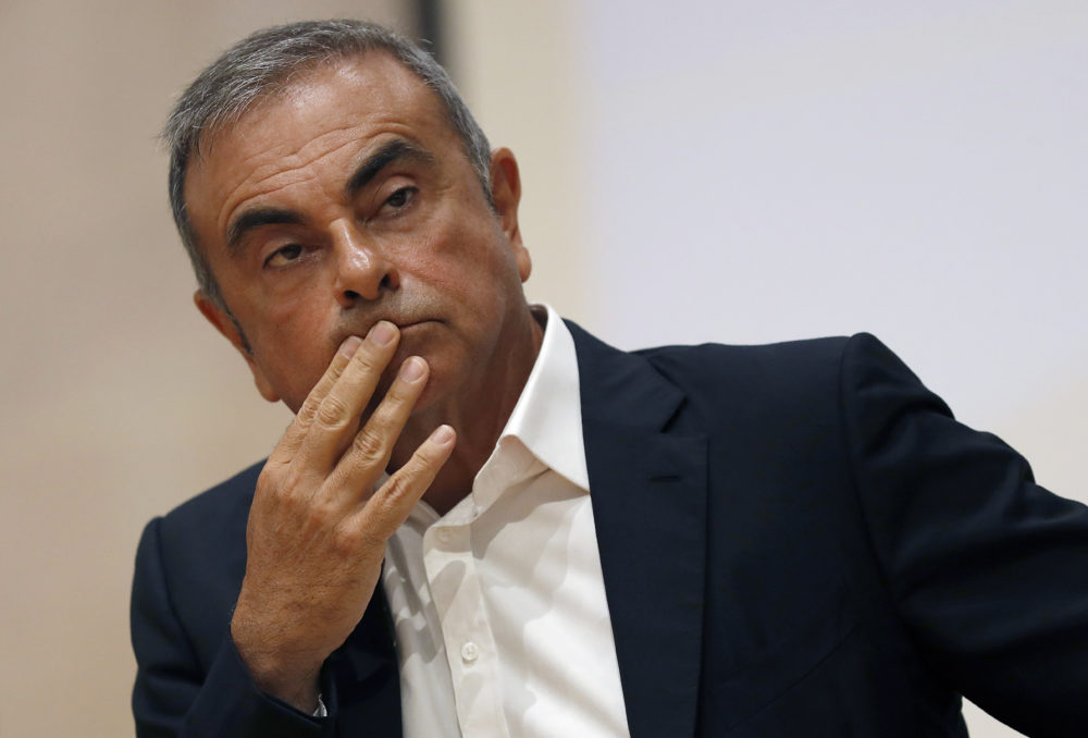 In this Sept. 29, 2020, file photo, former Nissan Motor Co. Chairman Carlos Ghosn holds a press conference. Japanese prosecutors have charged two Massachusetts men, Michael Taylor and his son Peter, in connection with the escape of Ghosn to Lebanon. (Hussein Malla/AP File)
