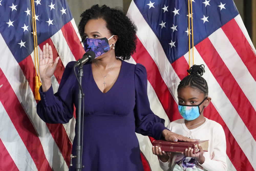 Former Boston City Council President Kim Janey is sworn in as Boston's new mayor at City Hall while her granddaughter, Rosie, holds a Bible, on March 24 in Boston. (Elise Amendola/AP)