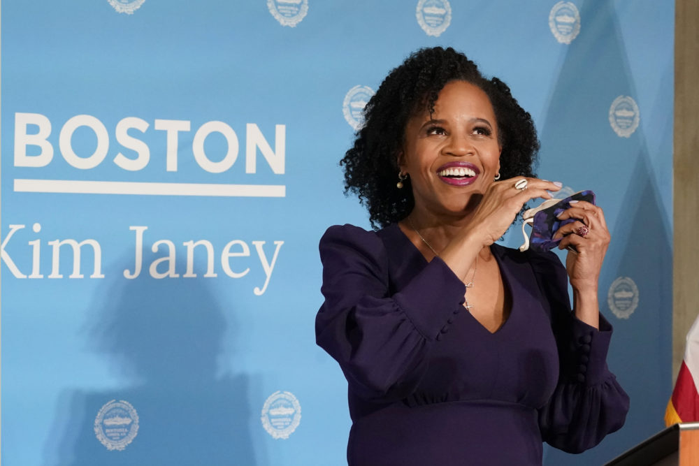 Former Boston City Council President Kim Janey, 55, takes off her face mask to speak after she was sworn in as Boston's new mayor at City Hall, Wednesday, March 24, 2021, in Boston. Janey, who is the city's first female and first person of color to take the office, replaces Marty Walsh who resigned Monday evening to become President Joe Biden's labor secretary. (AP Photo/Elise Amendola)