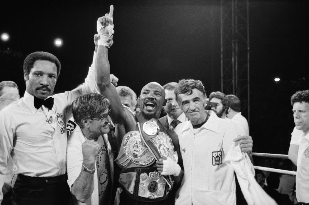 "Middleweight Champion Marvelous Marvin Hagler celebrates his undisputed world middleweight Championship with his manager, Pat Petronelli, and Co-Manager, Goody  Petronelli on Monday, April 15, 1985 in Las Vegas. Hagler knocked out Thomas ""Hitman"" Hearns in the third round to clinch the title. (AP Photo)"