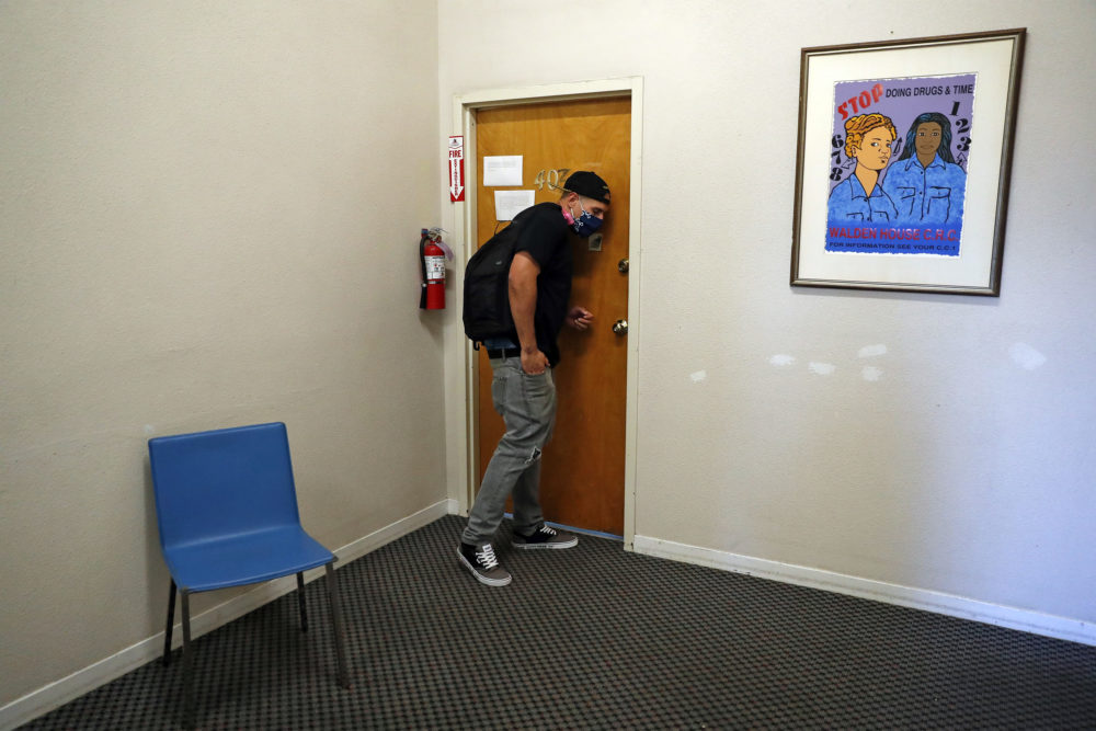 Client Chris Summers listens at a door at Walden House while trying to find his therapist for an appointment at HR360 in San Francisco, Calif., on June 16, 2020. Due to the coronavirus pandemic, those who are homeless or struggling with addiction may find it even harder to find treatment. (Scott Strazzante/The San Francisco Chronicle via Getty Images)