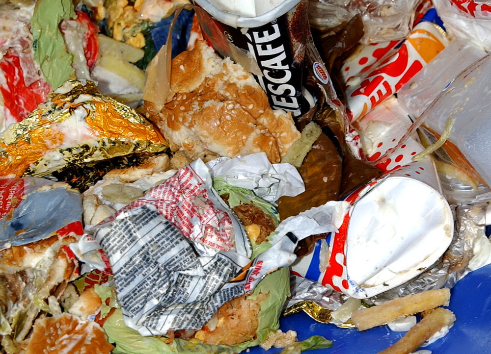 Trash overflows from a fast food restaurant's waste bin. (John Li/Getty Images)