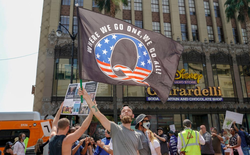 Conspiracy theorist QAnon demonstrators protest child trafficking on Hollywood Boulevard in Los Angeles, California, Aug. 22, 2020. (Kyle Grillot/AFP via Getty Images)