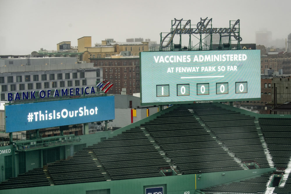 The scoreboard at Fenway Park displays a message that 10,000 vaccines have been administered as the park is opened as a COVID-19 public vaccination site on Feb. 16. The park will be allowed to reopen to fans in phase four. (Billie Weiss/Boston Red Sox/Getty Images)