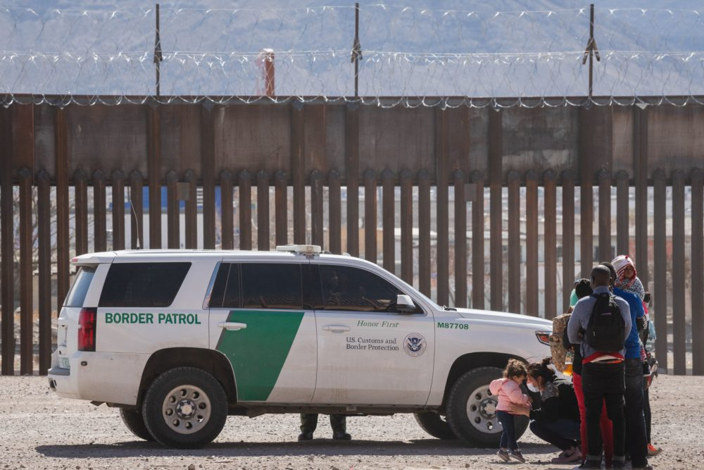 """Border Patrol agents apprehend a group of migrants near downtown El Paso, Texas following the congressional border delegation visit on March 15. President Joe Biden faced mounting pressure Monday from Republicans over his handling of a surge in migrants -- including thousands of unaccompanied children -- arriving at the US-Mexican border. Republican Congressman Kevin McCarthy of California, who leads his party in the House of Representatives, told reporters last week the """"crisis at the border is spiraling out of control."""" (JUSTIN HAMEL/AFP via Getty Images)"""