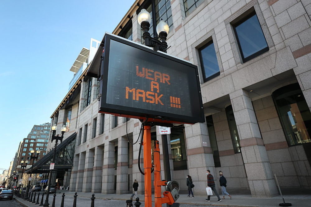 A sign outside the Hynes Convention Center gives instructions to people arriving for vaccines in Boston on March 19, 2021. (Suzanne Kreiter/The Boston Globe via Getty Images)