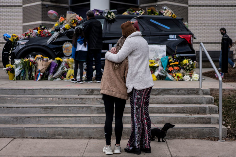 BOULDER, CO - MARCH 23: Sarah O'Keefe and Maura Kieft pay their respects to Officer Eric Talley, who was killed after a gunman opened fire at a King Sooper's grocery store on March 23, 2021 in Boulder, Colorado. (Photo by Chet Strange/Getty Images)