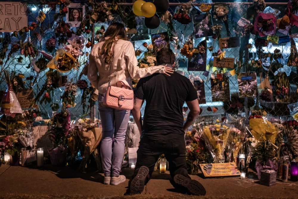 Mourners visit a memorial to those lost in a shooting at a King Soopers grocery store earlier in the week on March 27, 2021 in Boulder, Colorado. (Chet Strange/Getty Images)