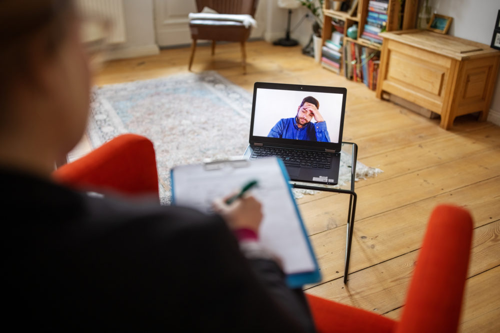A patient has a video call with mental health therapist. (Getty Images)