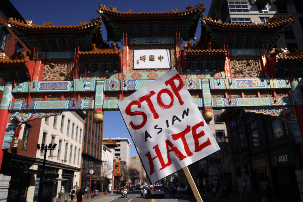 An activist holds a sign during a rally in response to the Atlanta, Georgia spa shootings that left eight people dead, including six Asian women. (Alex Wong/Getty Images)