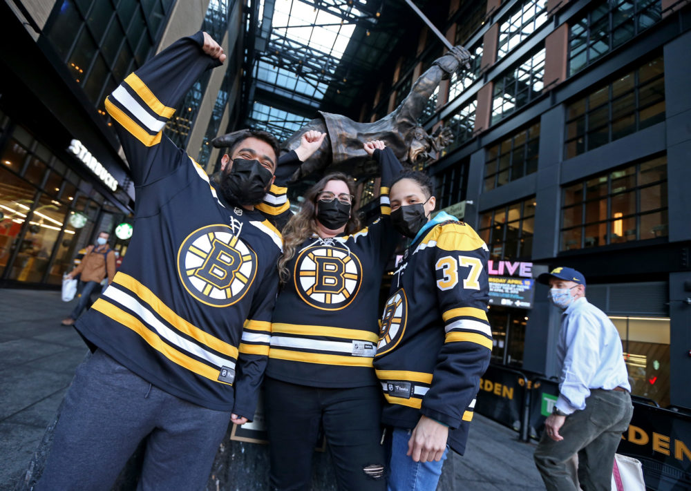 Bruins fans Luis Calderon, Kelsey Belair and Kiana Delgado of Leominster  get ready for the  NHL game against New York Islanders at the TD Garden on March 25, 2021 in Boston. (Matt Stone/MediaNews Group/Boston Herald via Getty Images)