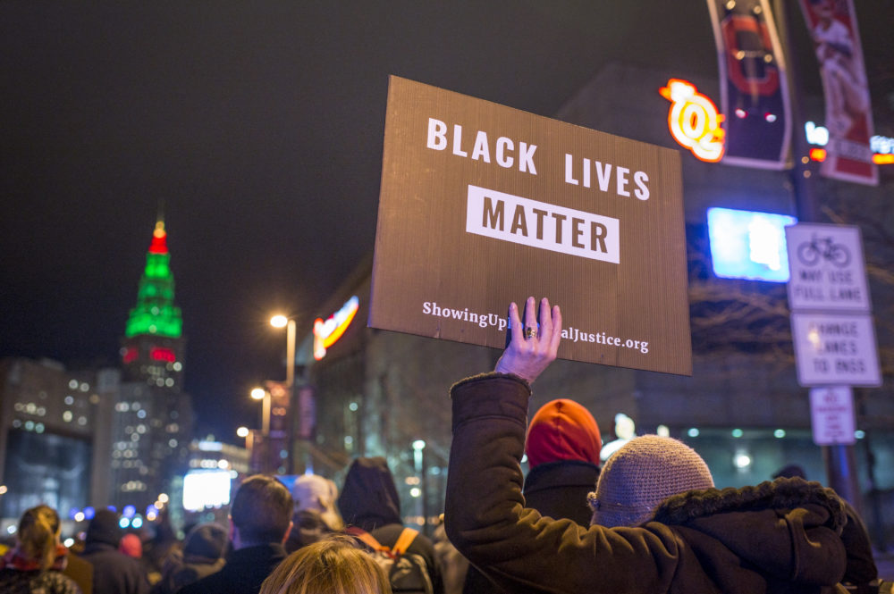 Demonstrators march on Ontario St. on Dec. 29, 2015 in Cleveland, Ohio. (Angelo Merendino/Getty Images)