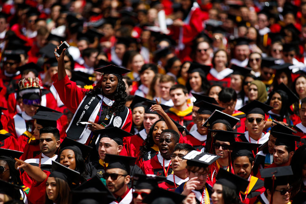 Students yell to President Barack Obama after he receives an honorary doctorate of laws during the 250th anniversary commencement ceremony at Rutgers University on May 15, 2016 in New Brunswick, New Jersey. (Eduardo Munoz Alvarez/Getty Images)