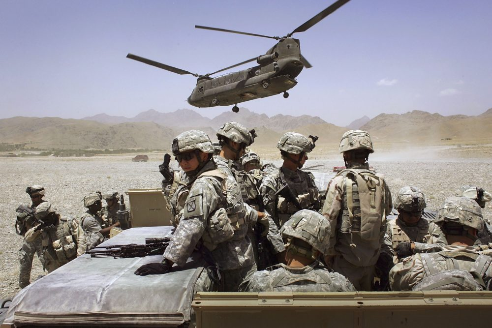 American soldiers from the 10th Mountain Division deploy to fight Taliban fighters as part of Operation Mountain Thrust to a U.S. base near the village of Deh Afghan on June 22, 2006 in the Zabul province of Afghanistan.  (Photo by John Moore/Getty Images)