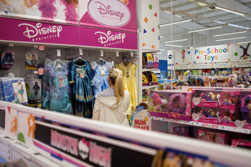 "A woman browses the costume selection in Toys ""R"" Us in 2017. (Leon Neal/Getty Images)"