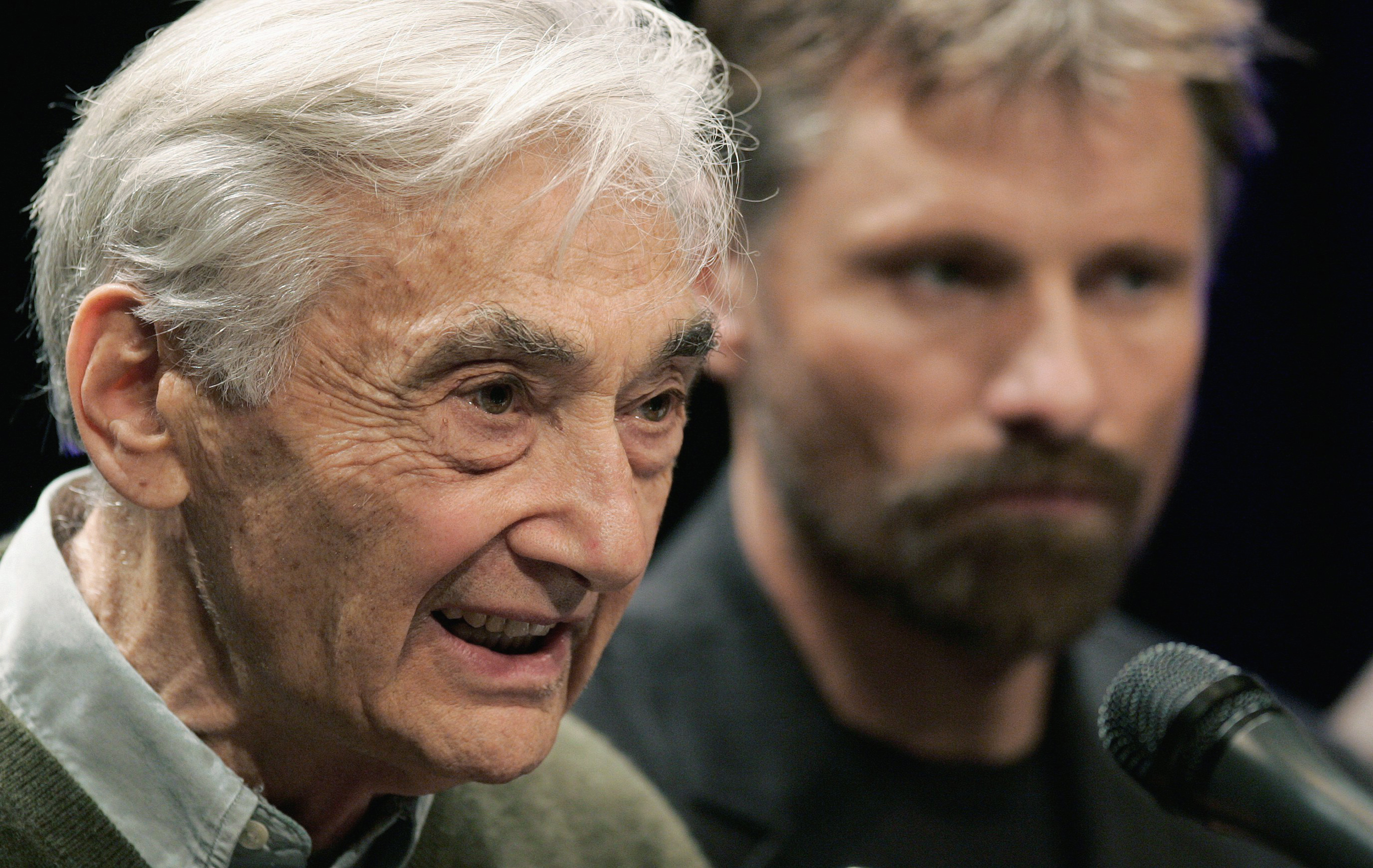 "Howard Zinn and actor Viggo Mortensen take part in a 2008 panel discussion about  ""The People Speak"" at  Emerson College in Boston.  (Michael Dwyer/AP)"