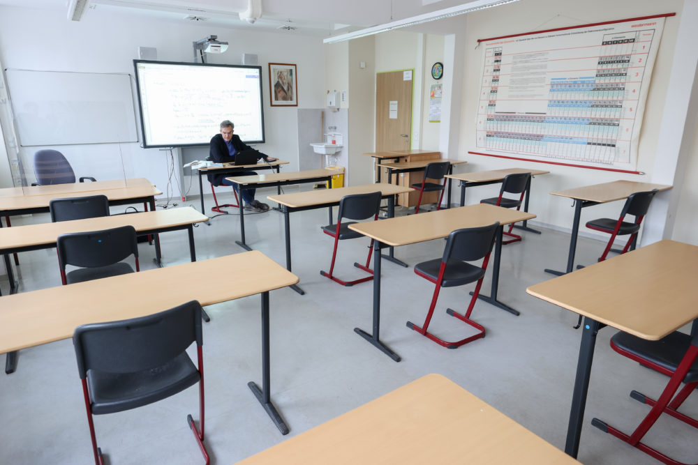 Steffen Jost, principal of Ostwaldgymnasium in Leipzig, Germany, holds an advanced physics class online from an empty classroom on Oct. 15, 2020. (Jan Woitas/picture alliance via Getty Images)