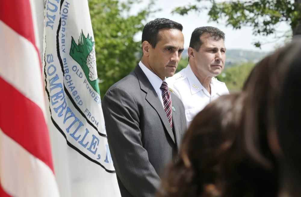Mayor Joseph Curtatone, left, during a news conference regarding immigration in Somerville in 2014. (Charles Krupa/AP)