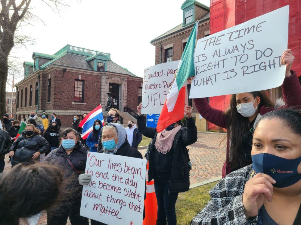 Protestors at Chelsea City Hall say the hardest-hit city in Massachusetts should be entitled to a larger share of federal relief money. (Tibisay Zea, El Planeta)