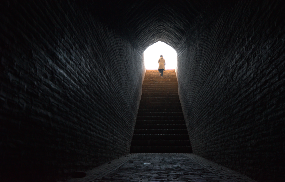 Woman walks up stairs  from a tunnel in Iran. (Getty)