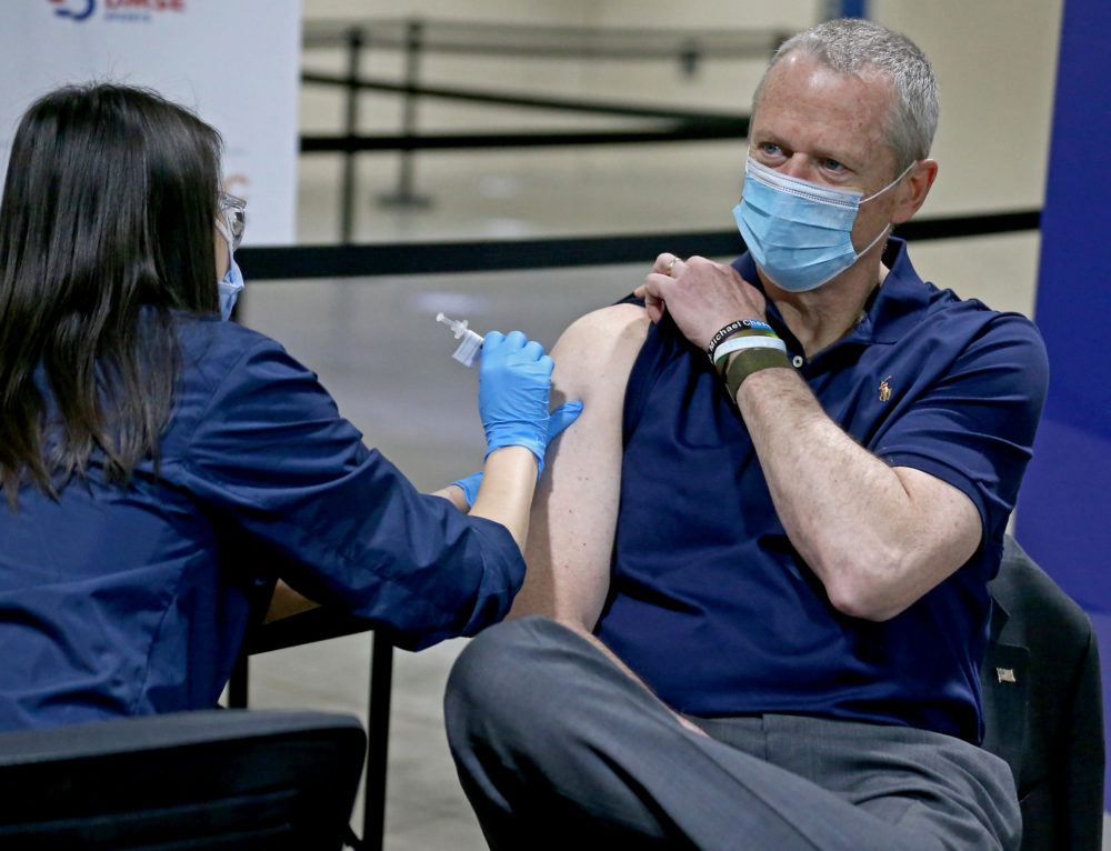 Gov. Charlie Baker receives his first dose of the COVID-19 vaccine at Hynes Convention Center on April 6. (Matt Stone/MediaNews Group/Boston Herald)