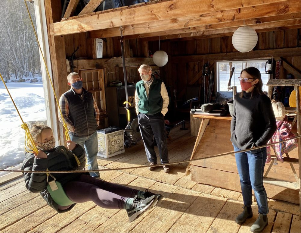 Three generations of the Shelov Hyde family in the barn behind their Sandwich vacation home. (Sarah Gibson/NHPR)
