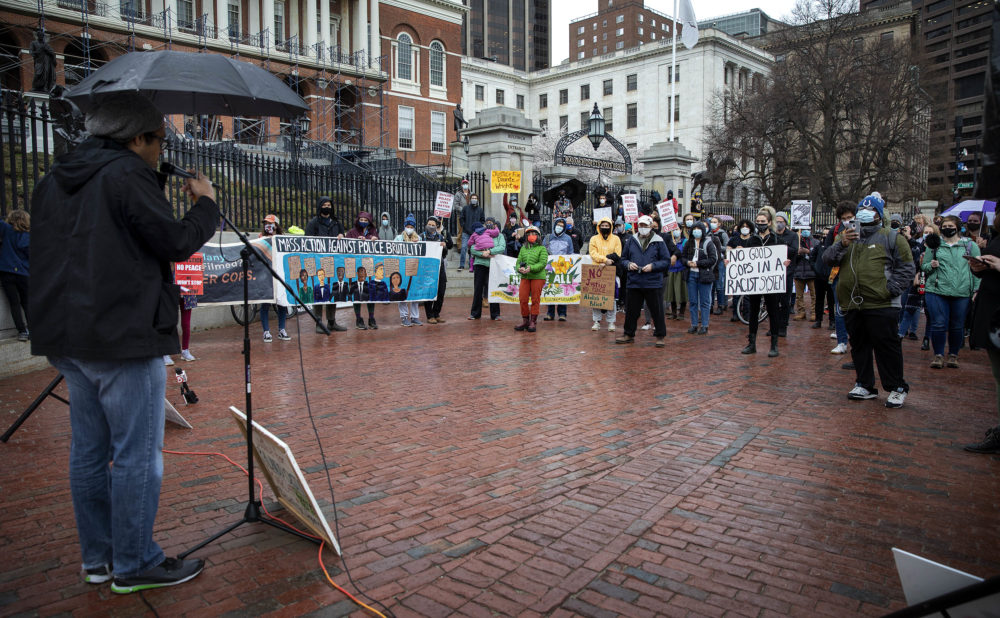 Brock Satter, a co-founder of Mass Action Against Police Brutality, speaks to protesters in front of the Massachusetts State House. (Robin Lubbock/WBUR)
