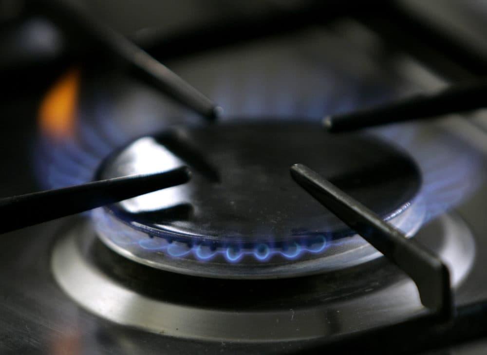 A gas-lit flame burns on a natural gas stove. (Thomas Kienzle/AP)