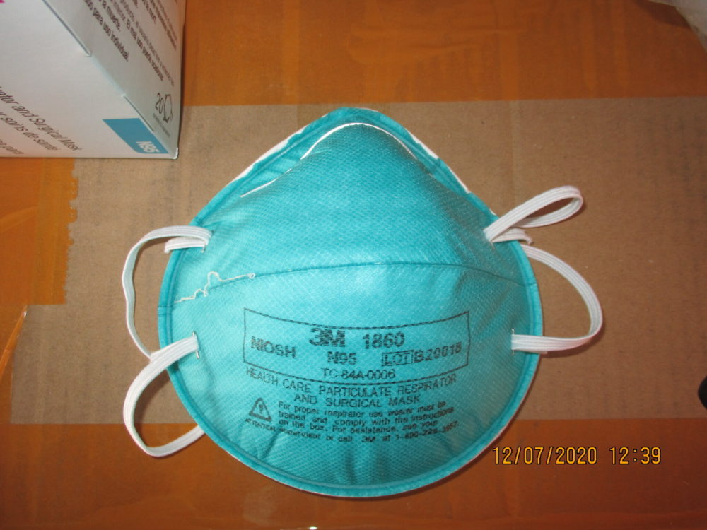 This December 2020 image provided by U.S. Immigration and Customs Enforcement (ICE) shows a counterfeit N95 surgical mask that was seized by ICE and U.S. Customs and Border Protection. (ICE via AP)