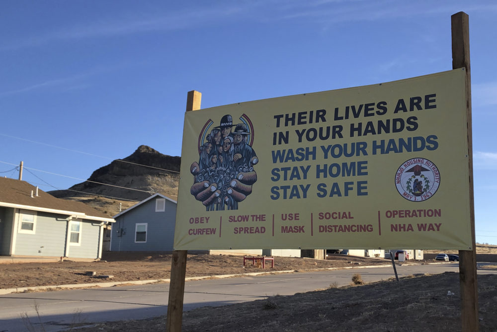 A sign urging safety measures during the  pandemic is seen in Teesto, Arizona, on the Navajo Nation on Feb. 11, 2021. (Felicia Fonseca/AP)