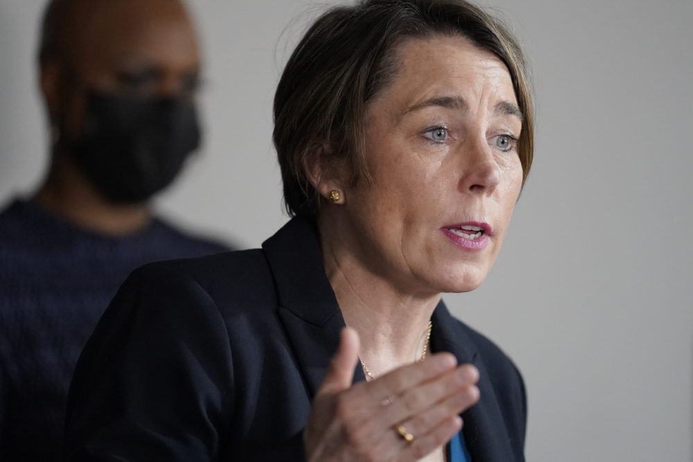 Mass. Attorney General Maura Healey, right, responds to questions from reporters as U.S. Rep. Ayanna Pressley, D-Mass., left, looks on during a news conference, April 1, 2021, in Boston. (Steven Senne/AP)