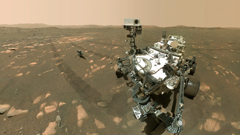 This image made available by NASA shows the Perseverance Mars rover, foreground, and the Ingenuity helicopter about 13 feet (3.9 meters) behind. (NASA/JPL-Caltech/MSSS via AP)