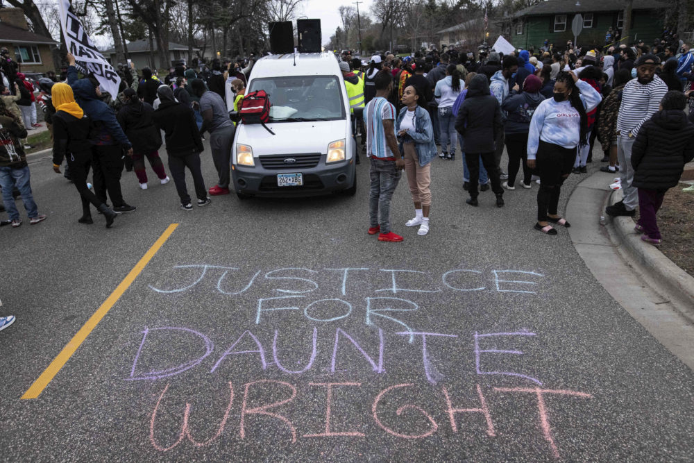 People gather in protest, Sunday, April 11, 2021, in Brooklyn Center, Minnesota. (Christian Monterrosa/AP)