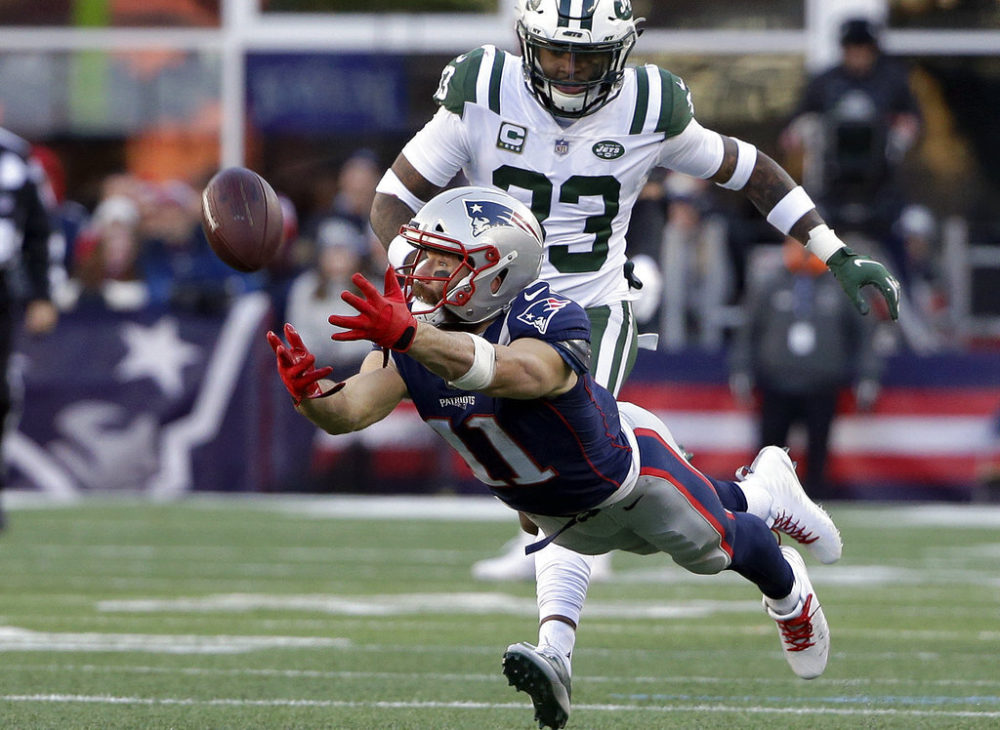 New England Patriots wide receiver Julian Edelman (11) stretches but cannot catch a pass in front of New York Jets safety Jamal Adams in 2018. (Steven Senne/AP)