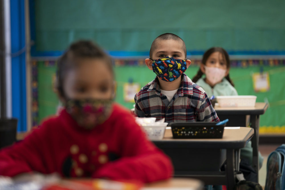 Kindergarten students sit in their classroom on the first day of in-person learning at Maurice Sendak Elementary School in Los Angeles, Tuesday, April 13, 2021. More than a year after the pandemic forced all of California's schools to close classroom doors, some of the state's largest school districts are slowly beginning to reopen this week for in-person instruction. (AP Photo/Jae C. Hong)