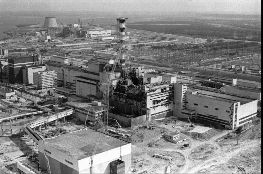 This April 26, 1986 file photo shows an aerial view of the Ukrainian Chernobyl nuclear plant, with damage from an explosion and fire in reactor four on that sent large amounts of radioactive material into the atmosphere. (Volodymyr Repik/AP)