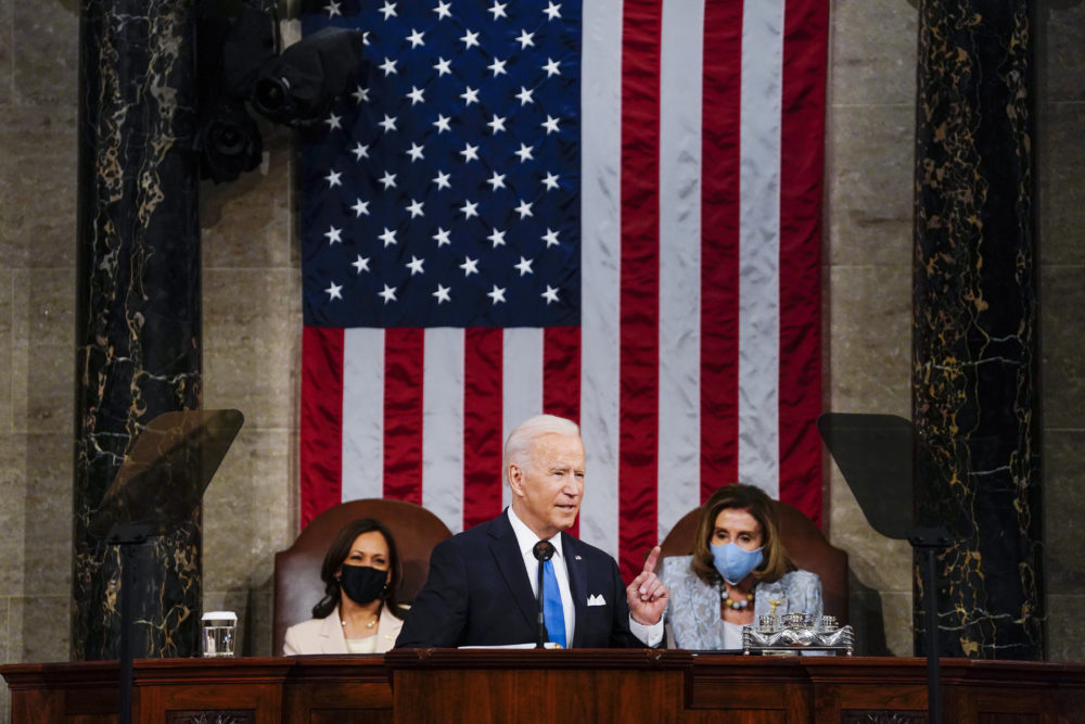President Joe Biden addresses a joint session of Congress, Wednesday, April 28, 2021, in the House Chamber at the U.S. Capitol in Washington, as Vice President Kamala Harris, left, and House Speaker Nancy Pelosi of Calif., look on. (Melina Mara/The Washington Post via AP)