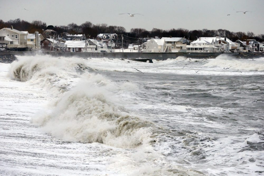 Ocean waves continue to come ashore a day after a winter storm in Scituate, Mass., Jan. 28, 2015.  (Michael Dwyer/AP)