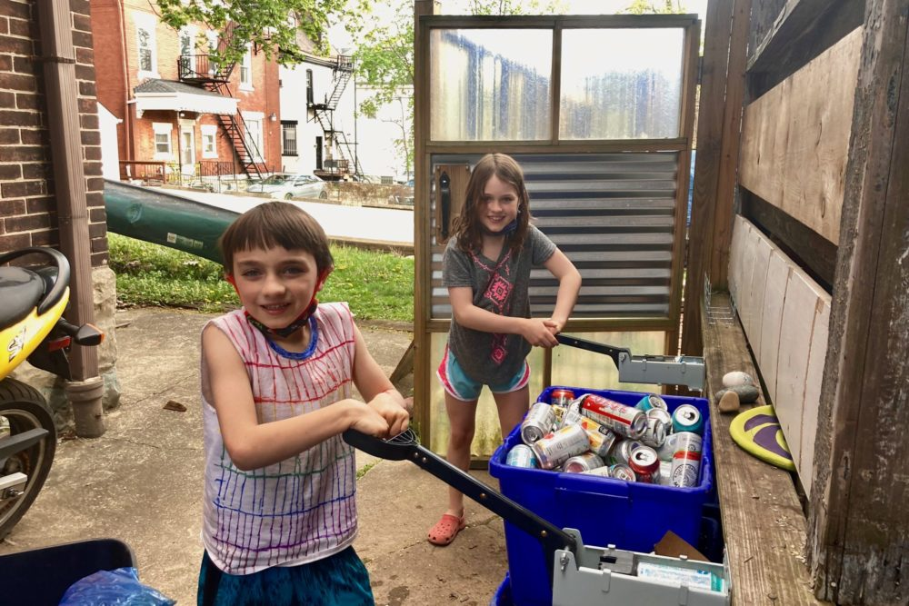 Siblings Teagan and Leo Ellsworth have been collecting — and crushing — cans in their Pittsburgh neighborhood since the pandemic began. (Andy Kubis for The Allegheny Front)