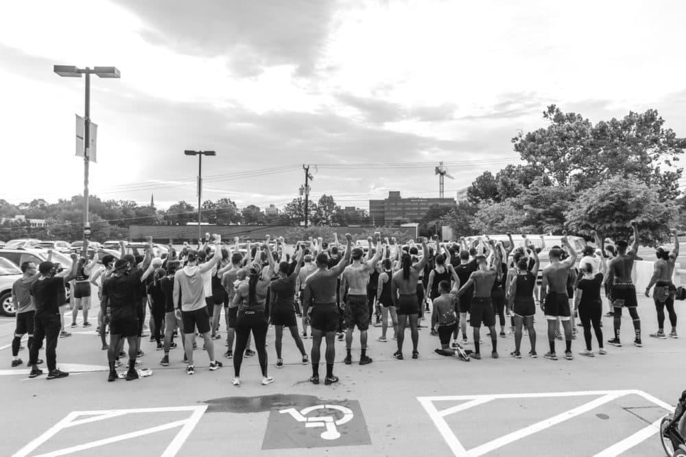 Prolyfyck Run Crew raise their arms following a run honoring Jacob Blake, who was paralyzed in a police shooting in Kenosha, WI. (Derrick J. Waller)