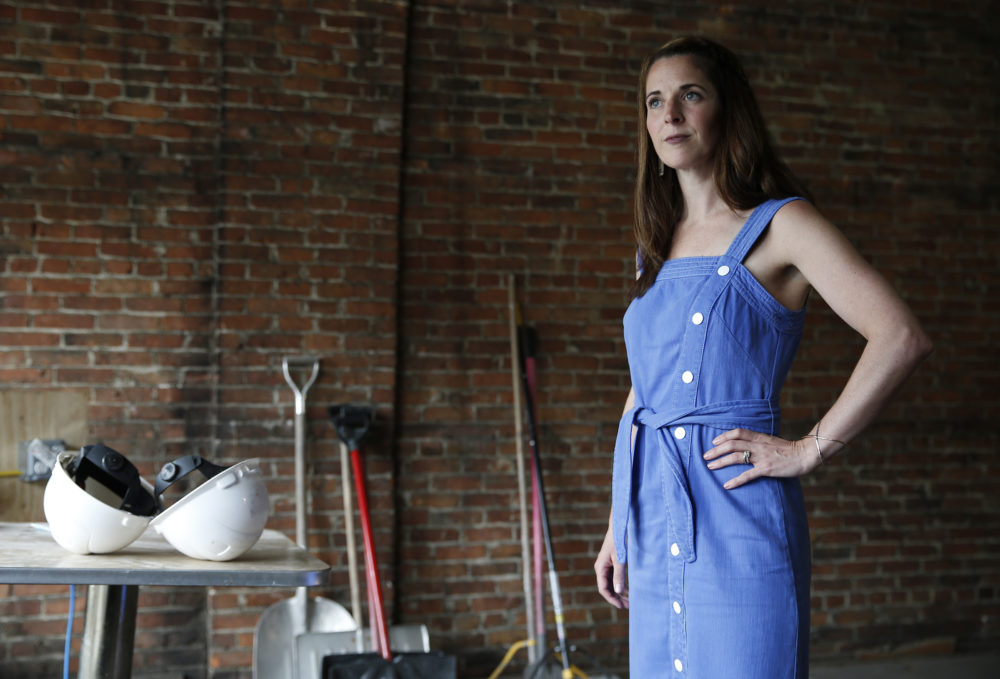 Caroline Pineau, a marijuana entrepreneur, poses for a photo inside the building she was renovating to turn into a pot shop in Haverhill on June 11, 2019. (Jessica Rinaldi/The Boston Globe via Getty Images)