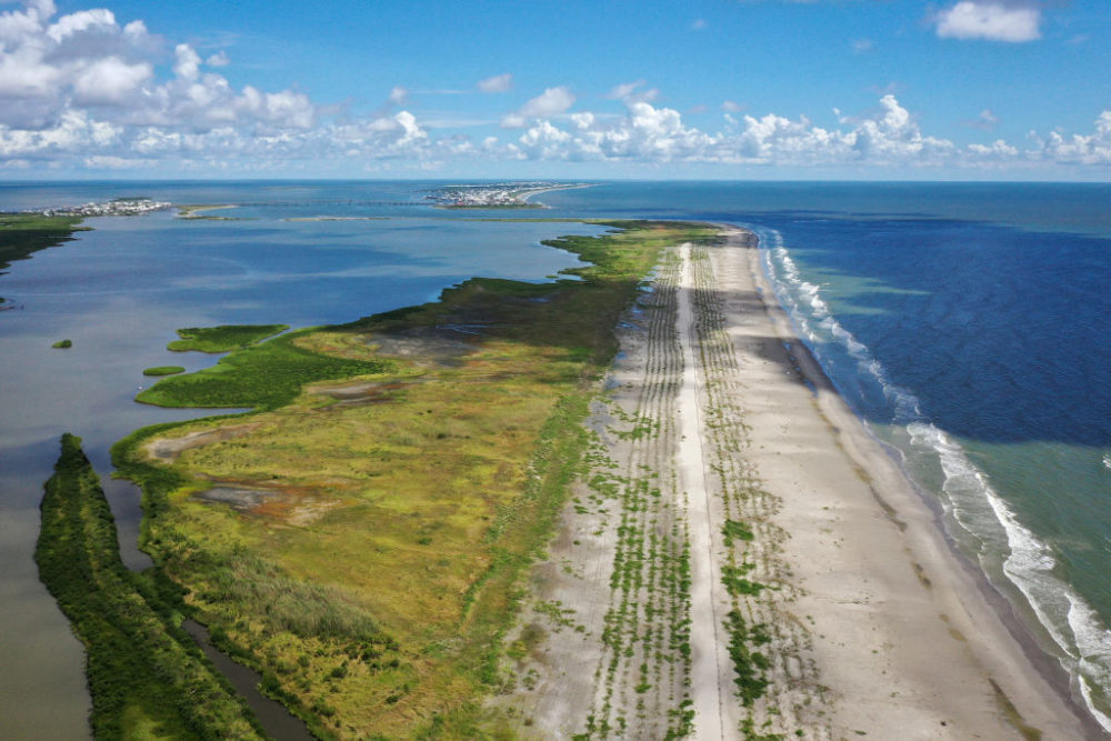 A view of the newly restored Caminada Headland, a 13-mile-long barrier island system that buffers the Louisiana coast from tropical storms and surge, August 24, 2019 in Grand Isle, Louisiana. According to researchers at the National Oceanic and Atmospheric Administration (NOAA), Louisiana's combination of rising waters and sinking land give it one of the highest rates of relative sea level rise on the planet. (Drew Angerer/Getty Images)