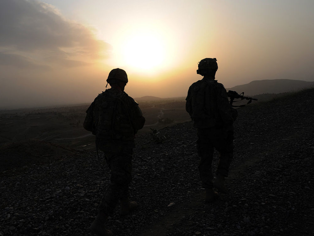 U.S. soldiers from Viper Company (Bravo), 1-26 Infantry are seen during sunset as they conduct a patrol at Combat Outpost Sabari in Khost province in the east of Afghanistan on June 21, 2011. (Ted Aljibe/AFP via Getty Images)