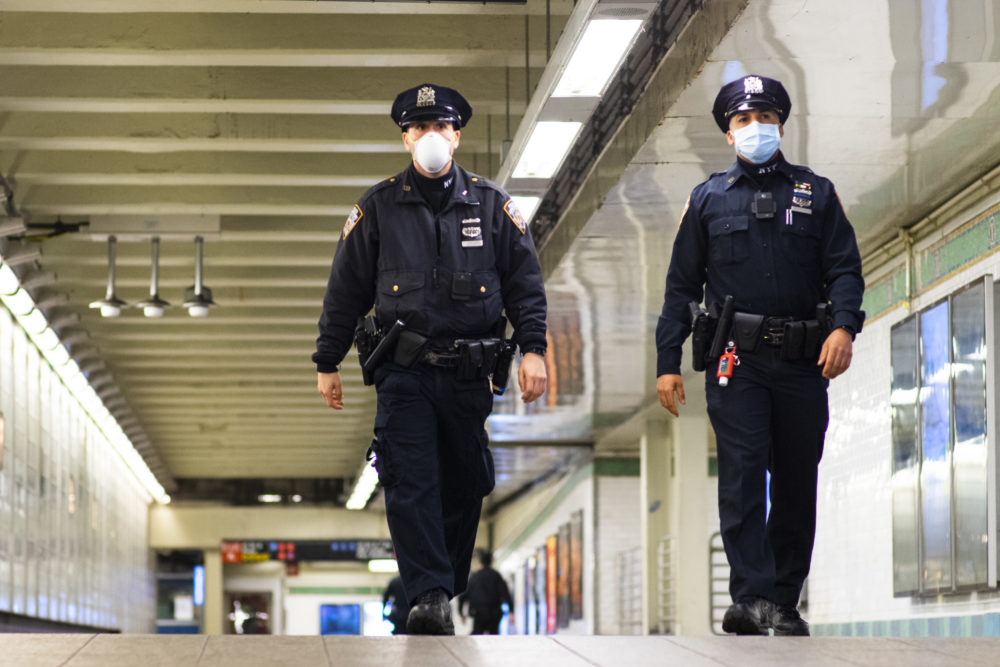 NYPD officers patrol inside Times Square station as the New York City subway system. (Eduardo Munoz Alvarez/Getty Images)